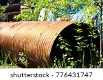 A Rusty Culvert Laying In A...