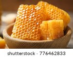 fresh honeycombs in wooden bowl ... | Shutterstock . vector #776462833