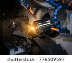 Small photo of Close up CNC milling/drilling machine working process on metal factory,Industrial metal work process at steel structure industry.