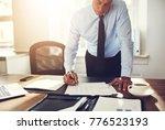 mature executive wearing a... | Shutterstock . vector #776523193