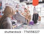 happy customer purchasing some... | Shutterstock . vector #776558227