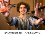 funny guy with instruments | Shutterstock . vector #776586943