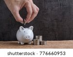 man hand putting coin into... | Shutterstock . vector #776660953