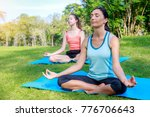 group of young woman meditating ... | Shutterstock . vector #776706643