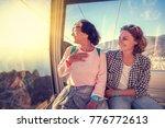 an elderly beautiful woman and... | Shutterstock . vector #776772613
