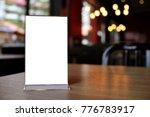 mock up menu frame standing on... | Shutterstock . vector #776783917