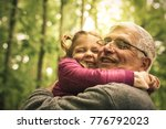 grandfather and granddaughter... | Shutterstock . vector #776792023
