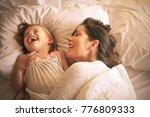 mother with her daughter enjoy... | Shutterstock . vector #776809333