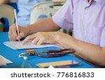 doctor is sitting patient... | Shutterstock . vector #776816833