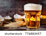 big glass with freshly poured... | Shutterstock . vector #776883457