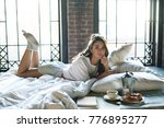 relaxed playful female wearing... | Shutterstock . vector #776895277