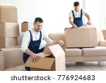 delivery men with moving boxes...   Shutterstock . vector #776924683