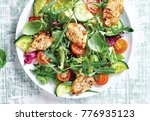 salad of vegetables and chicken | Shutterstock . vector #776935123