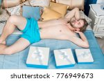 man in blue underwear sleep on... | Shutterstock . vector #776949673