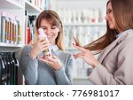 assistant at beauty store... | Shutterstock . vector #776981017