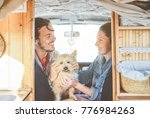 happy couple cuddling their dog ... | Shutterstock . vector #776984263