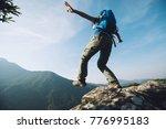 brave woman hiker keep balance... | Shutterstock . vector #776995183