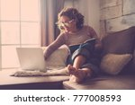 middle age woman working at... | Shutterstock . vector #777008593
