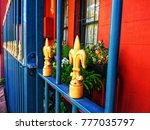 blue metal fence with yellow... | Shutterstock . vector #777035797