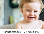baby girl laughing at home | Shutterstock . vector #777085543