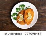 chicken schnitzel on plate over ... | Shutterstock . vector #777098467