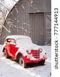 Small photo of KIEV, UKRAINE-DECEMBER 4, 2017: Red retro car under snow in winter time. Winter holiday celebration and Happy New Year concept, copy space. Red vintage car covered after a recent snowfall.