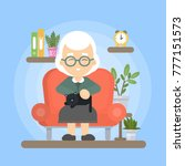 grandmother with cat sitting on ... | Shutterstock .eps vector #777151573