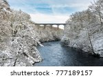 Snow Covered Trees Frame The...