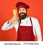 man or hipster with beard holds ... | Shutterstock . vector #777194743