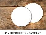 beer coaster mock up on wooden... | Shutterstock . vector #777205597