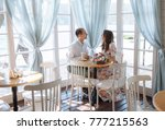 a loving couple sits at the... | Shutterstock . vector #777215563