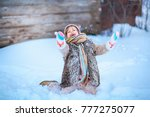 the girls playing with snow in...   Shutterstock . vector #777275077