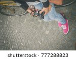 girl with a bicycle and retro... | Shutterstock . vector #777288823
