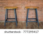 two wooden chairs on brick wall ... | Shutterstock . vector #777295417