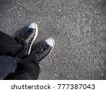 black sneakers on asphalt road. ... | Shutterstock . vector #777387043