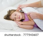 mother's hands covering little... | Shutterstock . vector #777543607