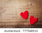pair of red hearts on vintage... | Shutterstock . vector #777568513