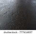 Small photo of Wet asphalt. Grey asphalt. Wet asphalt background. Wet asphalt texture. Grunge pavement.