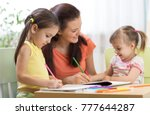 happy children with teacher... | Shutterstock . vector #777644287