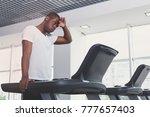tired handsome african american ... | Shutterstock . vector #777657403
