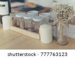 Small photo of Empty flavouring container on wooden table in the kitchen