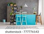 wooden bar stools and blue...   Shutterstock . vector #777776143