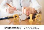 doctor in white uniform holding ... | Shutterstock . vector #777786517