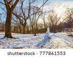 snowman in a spring park. sunny ... | Shutterstock . vector #777861553