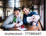 senior father and his young son ... | Shutterstock . vector #777880687