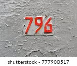 Small photo of The figure is seven hundred and ninety-six (red numbers on a gray background).