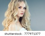 young nice blonde girl with... | Shutterstock . vector #777971377