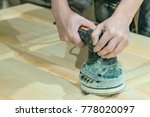 Carpenter Polishes The Wooden...