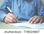 caucasian businessman signing a ... | Shutterstock . vector #778024807