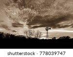 sepia tone windmill silhouette...
